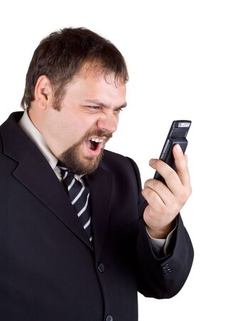 bawl: Businessman shouting into a mobile phone, isolated on white
