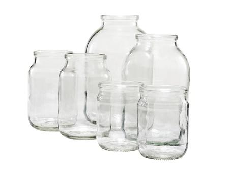 vaso vacio: Seis diferentes tama�os de envases de vidrio vac�os aislados en blanco Foto de archivo