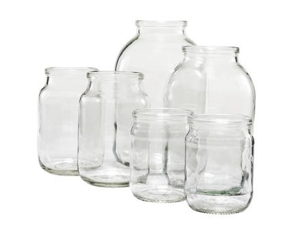 Six different sizes of empty glass jars isolated on white Stock Photo
