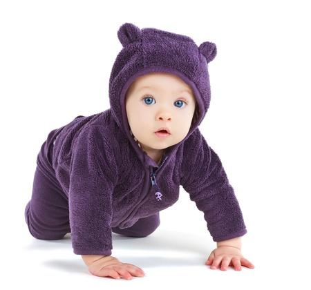 Baby crawling, isolated on white background