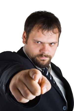 molesto: Hombre de negocios muestra el dedo índice, aisladas sobre fondo blanco