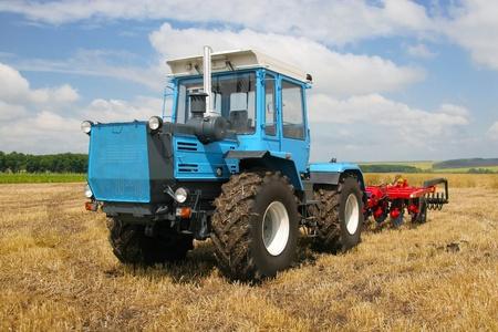 Big powerful traktoror on the field photo