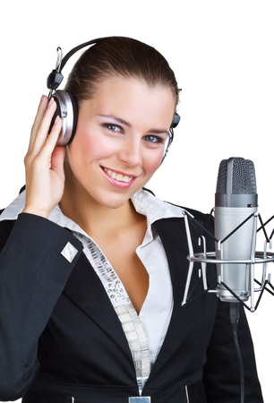 sound recording equipment: Smiling woman in front of a microphone headset, isolated on white background