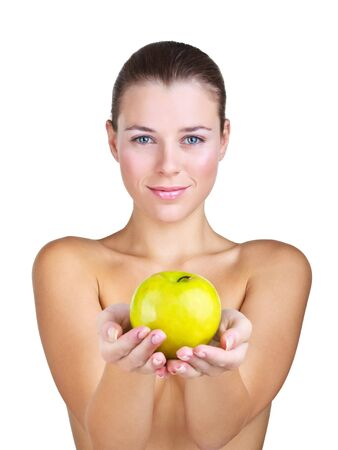 Woman holding apple in front of, isolated on white background photo