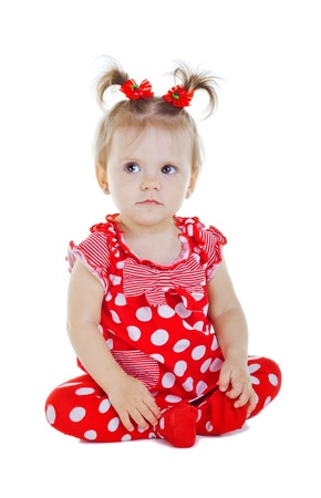 A small child in a red dress, isolated on white background Stock Photo