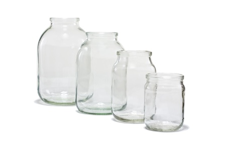 Four different sizes of empty glass jars, isolated on white background
