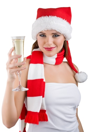 A beautiful woman dressed in a Christmas holding a glass of champagne, isolated on white background Standard-Bild
