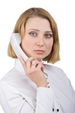 telephone receiver: Business woman in a white blouse with a telephone receiver in hand, isolated on white background Stock Photo