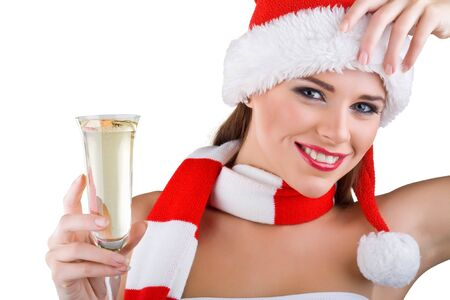 A beautiful woman dressed in Christmas holds a glass of champagne, isolated on white background photo