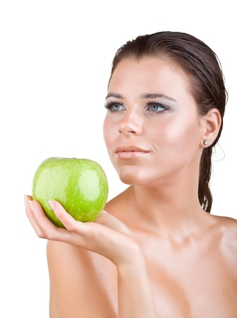 Beautiful girl holds in a hand green apple, isolated on white background Stock Photo - 11052654