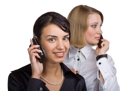 Two business women talking on mobile phone, isolated on white background Stock Photo - 11052653