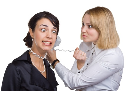 business disagreement: Business woman with telephone wire strangling another woman, isolated on white background
