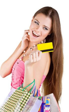 Smiling beautiful woman pulled from the purse Credit card, isolated on white background photo