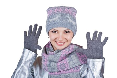 Woman in winter clothing shows his hand, isolated on white background photo