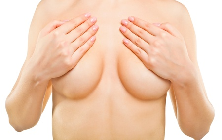 Sexy beautiful woman covering her nude breast, isolated on white background