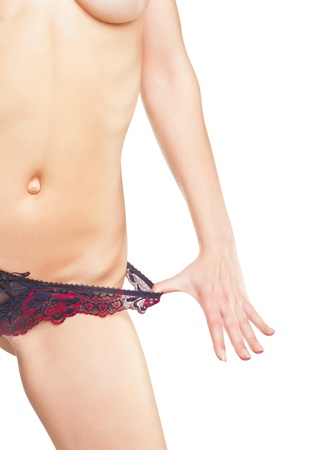 Sexy young woman pulls her panties, isolated on white background photo