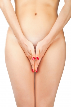Part of a nude woman body with close hands between the legs isolated on white background