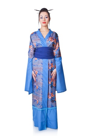 Young woman in Japanese kimono isolated on white background