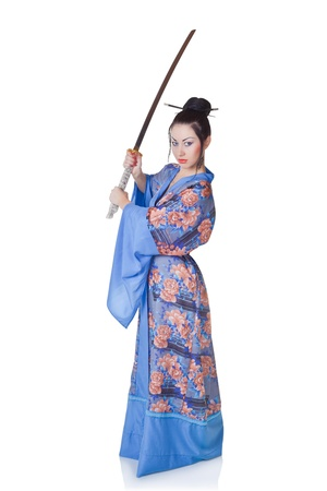 Beautiful woman in a kimono with samurai sword isolated on white background