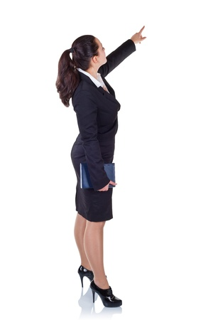 Business woman showing a finger at the copy space  isolated on white background