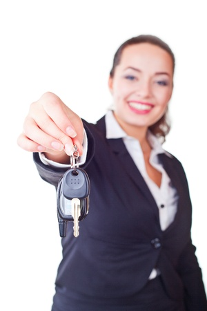 Portrait of business woman with the keys on a light background  Focus on key photo
