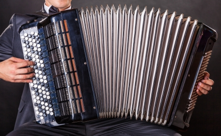 Close-up musician playing the accordion photo
