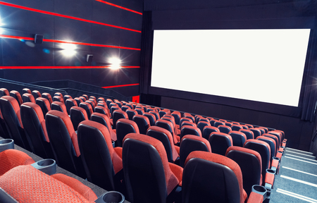 Empty cinema auditorium with screen and seats Standard-Bild