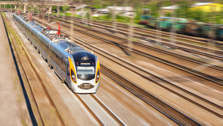 Modern high speed train on a clear day with motion blur photo