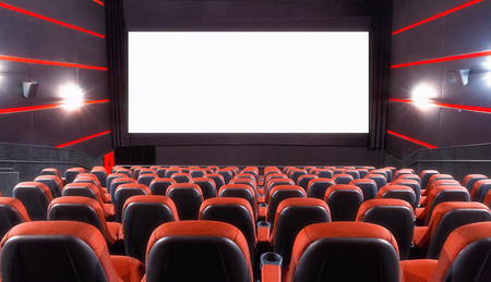Empty cinema auditorium with screen and seats Stock Photo