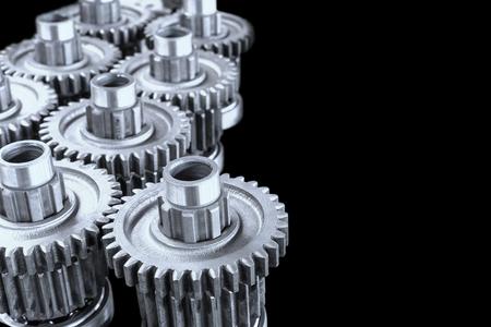 interlocking: Interlocking industrial metal gears on black background Stock Photo