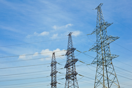 isolator high voltage: Transmission lines on the background against the blue sky