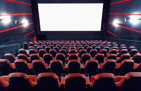 Empty cinema auditorium with screen and seats Stock Photo