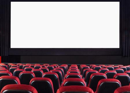 Empty cinema auditorium with screen and seats photo