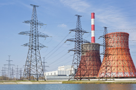 cooling towers: Thermal power stations and power lines on a clear day Stock Photo