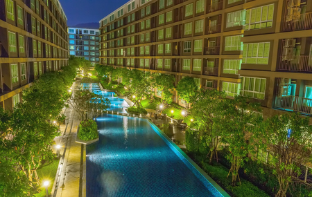 The complex is modern condominium with pool