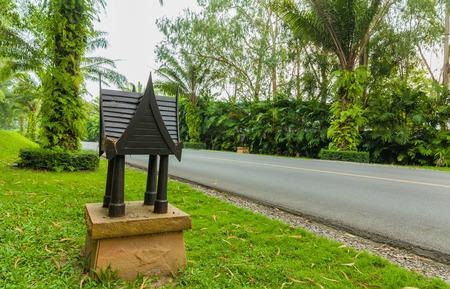 Asphalt road in green nature, Thailand photo