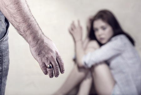abuse young woman: Woman victim of domestic violence and abuse. Focus on hand