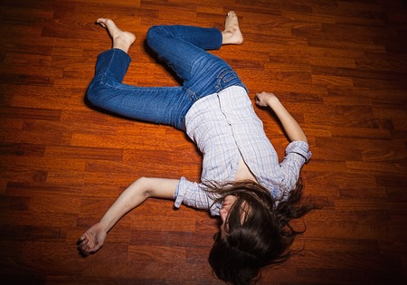 Lying on the floor of a lonely young woman in a empty room photo