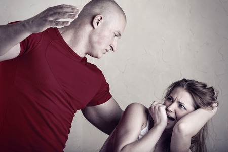 abusive man: Woman victim of domestic violence and abuse. Husband beats his wife