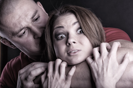psycho social: Domestic violence woman being abused and strangled by strong man