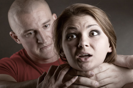 men s: Domestic violence woman being abused and strangled by strong man
