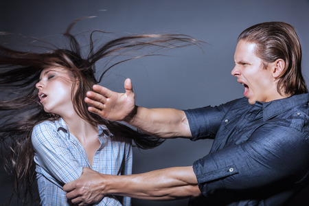 physical pressure: Woman victim of domestic violence and abuse. Husband beats his wife