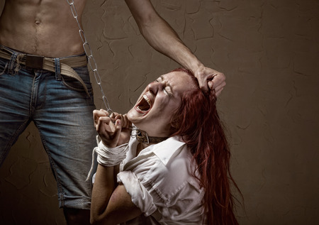 victims: Woman victim of domestic violence and abuse. Husband mocks his wife