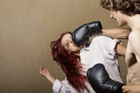 pain killers: Woman victim of domestic violence and abuse. Husband beats his wife in boxing gloves
