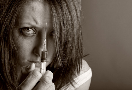 smack: Young woman with drug addiction. Black and white photo