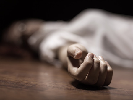 scary girl: The dead womans body. Focus on hand