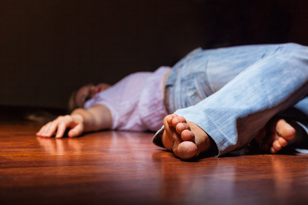 The dead womans body. Focus on the foot photo
