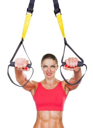 Athletic woman with functional loops for training isolated on white background