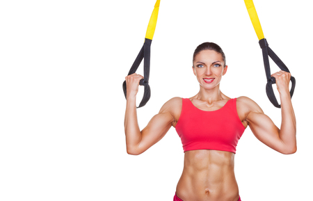 Athletic woman with functional loops for training isolated on white background photo