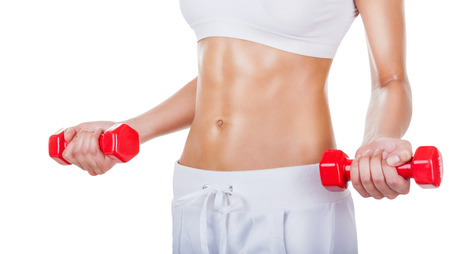 Torso of a young fit woman lifting dumbbells isolated on white background